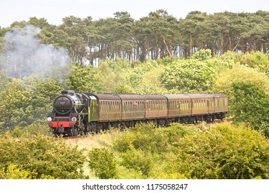 WEYBOURNE, NORFOLK, UK - JUNE 23, 2012: LMS Stanier Class 5 4-6-0 No. 45337 operates a passenger service at the North Norfolk Railway during the 'Titfield Thunderbolt' event.