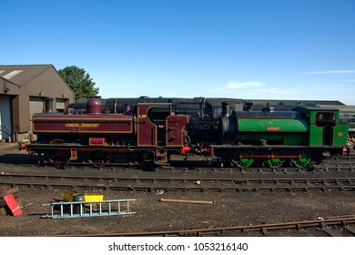 WEYBOURNE, NORFOLK, UK - JUNE 26, 2011: Steam locomotives London Transport pannier tank No. L99 and Hunslet 0-6-0ST No. 1982 'Ring Haw' stand outside Weybourne Shed during the NNR's diesel gala.