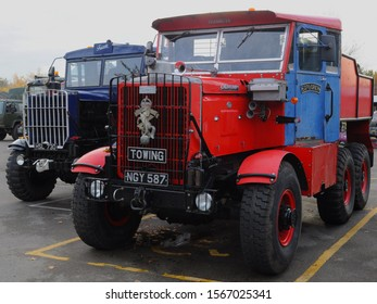 Weybridge, Surrey / UK - 11/17/2019: 1962 Scammell Explorer 'Trixie' (l) and 1952 Scammell Explorer (r) with REME crest at the Brooklands Museum's 2019 Military Vehicle Day.