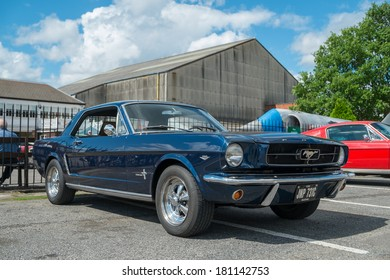 WEYBRIDGE, SURREY, UK - AUGUST 18:  1965 Blue Ford Mustang Coupe on show at the annual Brooklands Motor Museums Mustang and Anything American Day in August 18 2013.