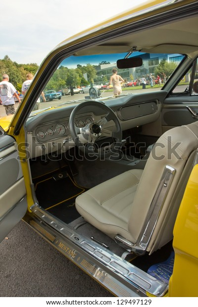 WEYBRIDGE, SURREY, UK - AUGUST 19:  An interior view of a yellow Ford Mustang on show at a Mustang Meet on August 19, 2012 at Brooklands Motor Museum in Weybridge, Surrey, UK