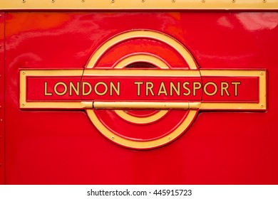 WEYBRIDGE, SURREY, UK - AUGUST 9, 2015: A vintage Red London Transport badge on a vintage London bus at the London Bus Museum at Brookland Motor Museum in August, 2015.