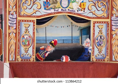 WEYMOUTH, DORSET, ENGLAND - AUGUST 31: Traditional Punch and Judy puppet show performance on the beach at Weymouth on August 31 2012.  The historic show is attracting holidaymakers back to the resort.