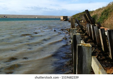 Weymouth Dorset England October 2019. The Fleet. Separated from the sea by Chesil Beach. Ancient pebble breakwater. Fishermen's huts, boats and WW2 pill box. The Dam Busters practiced here.