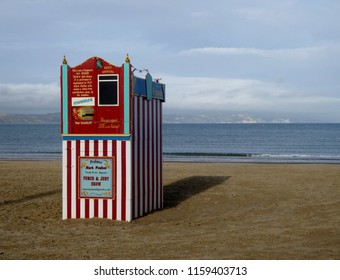 Weymouth, Dorset, UK, August 14th 2018 , a traditional British seaside children's entertainment Punch and Judy theatre on an empty evening beach