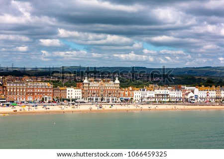 Weymouth in Dorset, UK, sandy beach with Georgian architecture panorama view in sunny Summer day. Full frame horizontal view from top of seaside