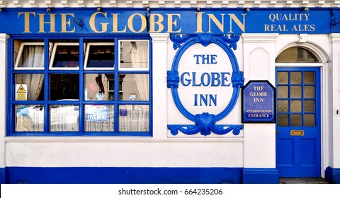 WEYMOUTH, UK - JUNE 3, 2017. Ground floor facade of the Globe Inn, an old pub in Weymouth, a town in the county of Dorset on the the south coast of England, UK.