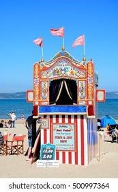 WEYMOUTH, UNITED KINGDOM - JULY 18, 2016 - Colourful Punch and Judy Show hut on the beach, Weymouth, Dorset, England, UK, Western Europe, July 18, 2016.