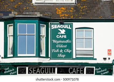 WEYMOUTH, UNITED KINGDOM - JULY 19, 2016 - Traditional fish and chips shop signs along the Esplanade, Weymouth, Dorset, England, UK, Western Europe, July 19, 2016.