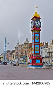 Weymouth,Dorset / England - 6/24/2019: The Jubilee Clock Tower was erected on the Esplanade to commemorate the Golden jubilee of Queen Victoria in 1888. Grade II Listed. The Royal Hotel in background.