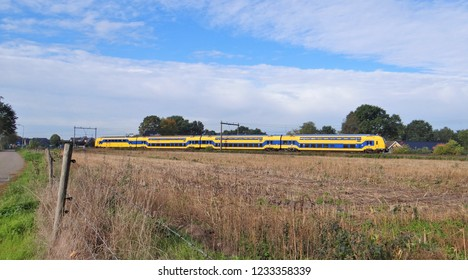 Wezep / Netherlands - October 11 2018: A Dutch modern double decker NS Intercity train (type DDZ) with a meadow at the foreground near by the station of Zwolle