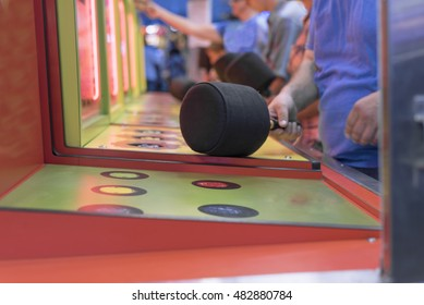 whack a mole game at amusement park close up