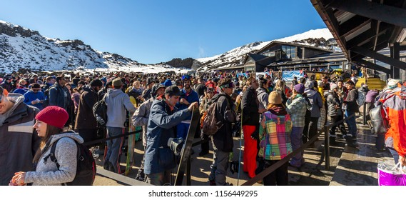 Whakapapa, New Zealand - August 11, 2018: Skiiers line up for chairlift tickets on a busy Saturday at Whakapapa Ski Field, New Zealand.