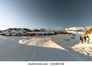 Whakapapa, New Zealand - August 12, 2018: Skiiers line up for chairlift on a busy Sunday at Whakapapa Ski Field, New Zealand.
