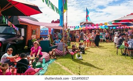 Whangamata, New Zealand - January 03, 2015: Tourists enjoying the live music and family entertainment at The Extravaganza Fair in Whangamata, New Zealand