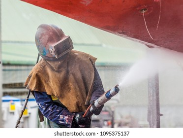 Whangarei,New Zeland/North Island,12-05-2017, man, sandblasting the corroded hull of a sailboat