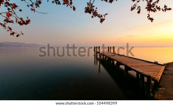 Wharf on Garda lake at sunset