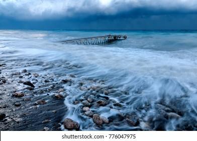 wharf in the sea during a hurricane