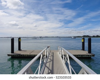 Wharf Tauranga Waterfront Harbor side crystal clear turquoise water and blue sky