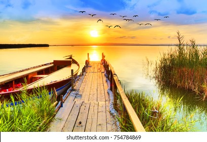 Wharf of wood in the Lake under the sunset