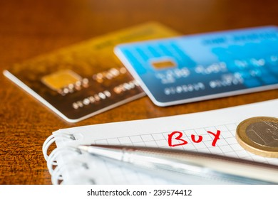 What to buy, ideas for shopping, credit cards with a pen on the table