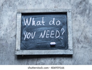 What do you need? - handwritten on a chalkboard