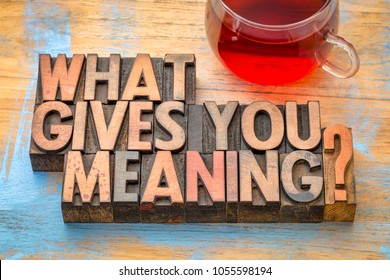 What gives you meaning? A question in vintage letterpress printing blocks with a cup of tea.