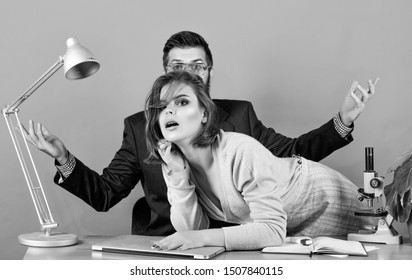 what is going on. business couple at computer. sexy woman and man work in office at laptop. corporate ethics. businessman and assistant. secretary with boss at workplace. love affair at work.