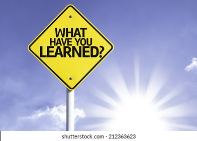 What Have You Learned? road sign with sun background