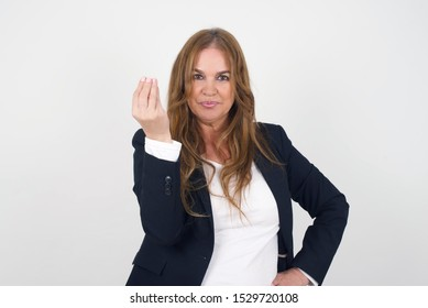 What the hell are you talking about. Shot of frustrated European woman gesturing with raised hand doing Italian gesture, frowning, being displeased and confused with dumb question.