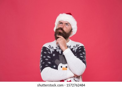 What if. Hipster bearded man wear winter sweater and hat. Happy new year. Winter plan. Man thoughtful face expression. Hard decision. Decision making. Make christmas wish. Life changing decision.