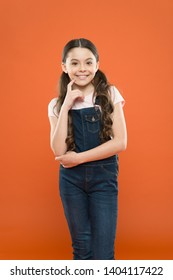 What is key to childhood happiness. Happy childhood. Grow mentally and physically healthy child. Wellbeing and health. Childhood concept. Fashion girl. Girl adorable kid stand over orange background.