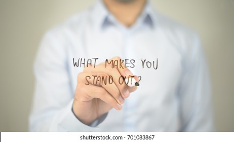 What Makes You Stand out, man writing on transparent screen
