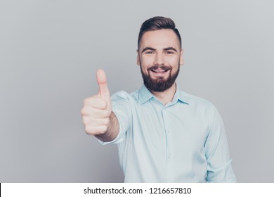 What a nice offer! Close up photo portrait of handsome attractive nice kind friendly honest cheerful him he human economist lawyer make give finger up look at camera isolated grey background copyspace