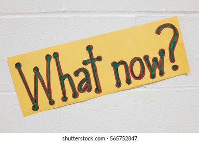 What Now Sign on a School Wall