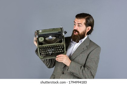 what a surprise. bearded man in jacket with retro type writer. new technology in modern life. Man working on retro typewriter in library. mechanical vs digital. writer writes with typewriter.