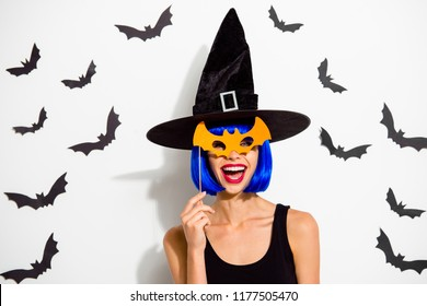 What is so terrible here its funny?! Close up portrait of winsome, lovable, fascinating lady look at camera make wide shine toothy smile, hold orange paper mask near face isolated on white background