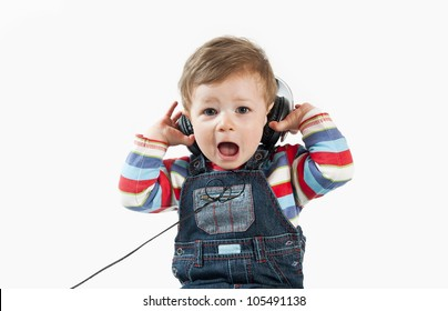 What is that noise? Baby with headphone,isolated on a white background.