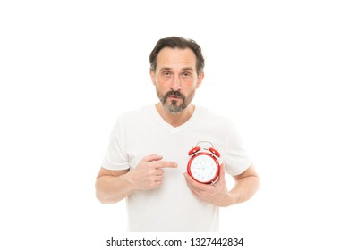 What time is it. Time management and discipline. Punctuality and responsibility. Man with clock on white background. Check time. Man hold alarm clock in hand. Guy bearded mature man worry about time.