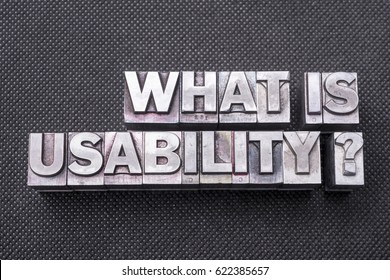what is usability question made from metallic letterpress blocks on black perforated surface