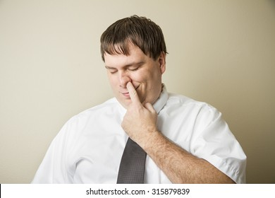 What a way to relax on the job with your fingeru p your nose