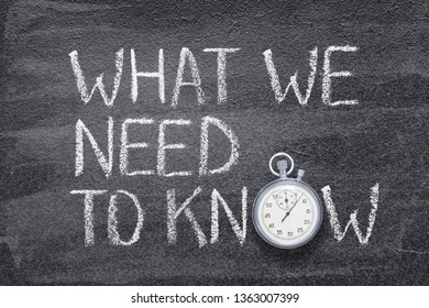 what we need to know phrase written on chalkboard with vintage precise stopwatch