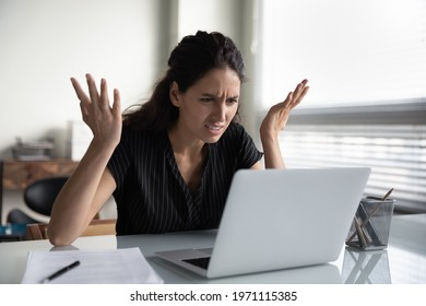 What is wrong. Anxious angry hispanic female splash hands unable to access database on laptop forgetting password having weak wifi signal. Mad shocked young woman worker losing job result on broken pc