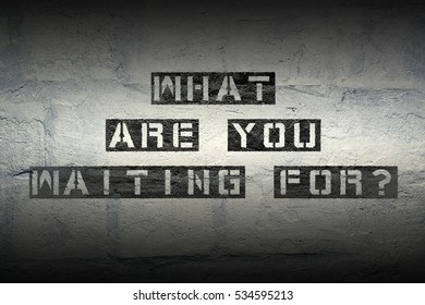 what are you waiting for stencil print on the grunge white brick wall