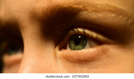 What your eye says about your health. Small boy in eye lens. Little boy have poor eyesight. Eyesight correction at oculist. Oculist prescribe lens. Childhood care. Struggling with poor health.
