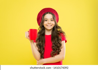 What is your favorite juice. Drink enough water. Girl kid hold mug yellow background. Child hold mug. Drinking tea juice cocoa. Relaxing with drink. Child smiling drink beverage. Homebrewed drink.