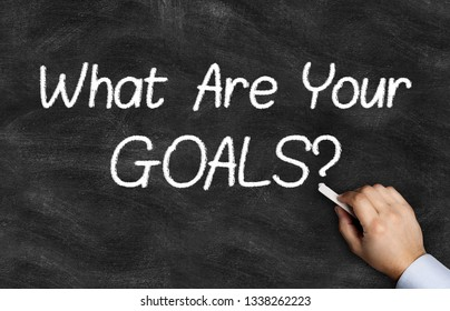 What Are Your Goals question handwriting with chalk on blackboard.