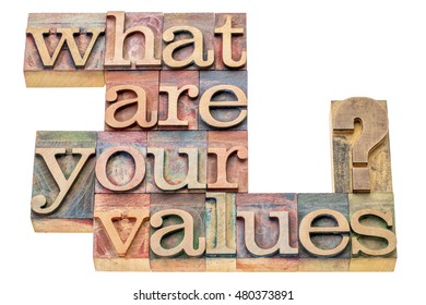 What are your values question - isolated word abstract in letterpress wood type printing blocks stained by color inks