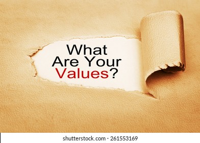 What Are Your Values? written behind torn paper
