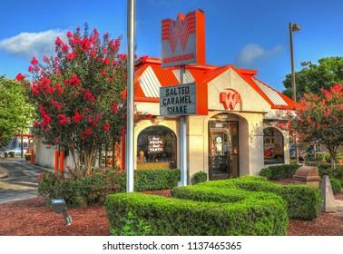 Whataburger fast food restaurant storefront entrance, Austin Texas USA, June 30, 2018